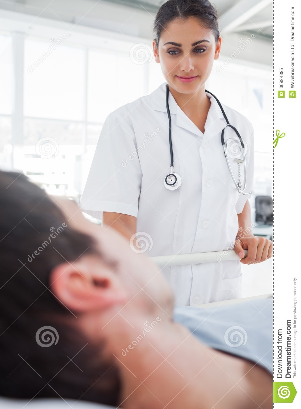 Smiling Nurse Taking Care Of A Patient Royalty Free Stock ...