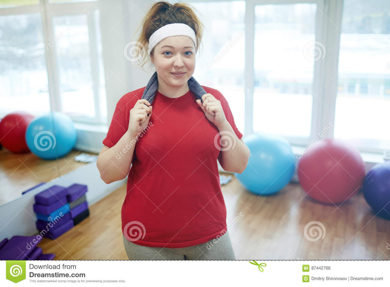 Smiling Obese Woman after Workout in Fitness studio