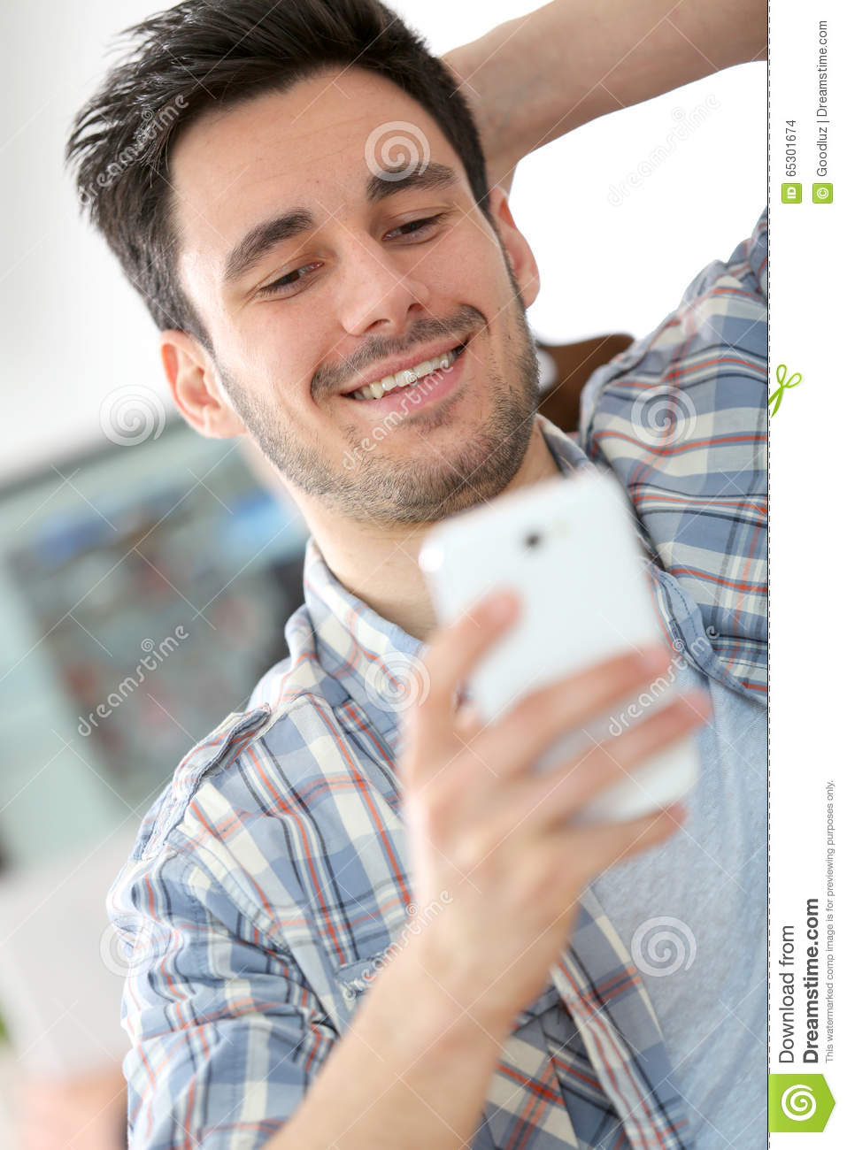 Smiling office worker with smartphone