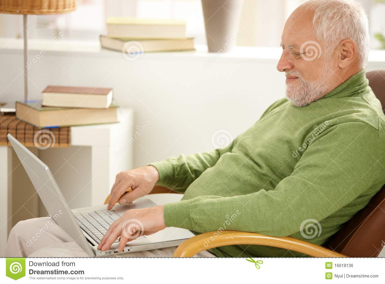 Smiling Pensioner Using Laptop Computer Royalty Free Stock