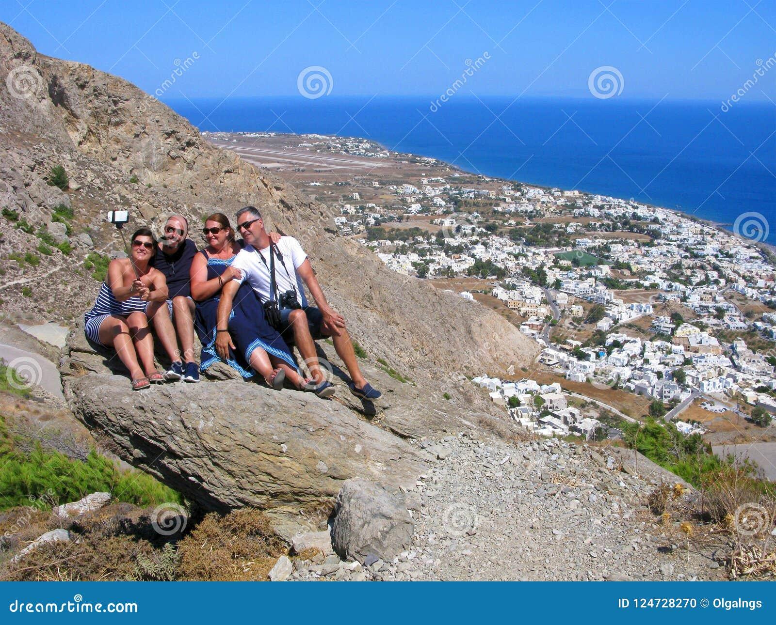 Smiling people, Greece, Santorini, selfie, top view of Kamari beach