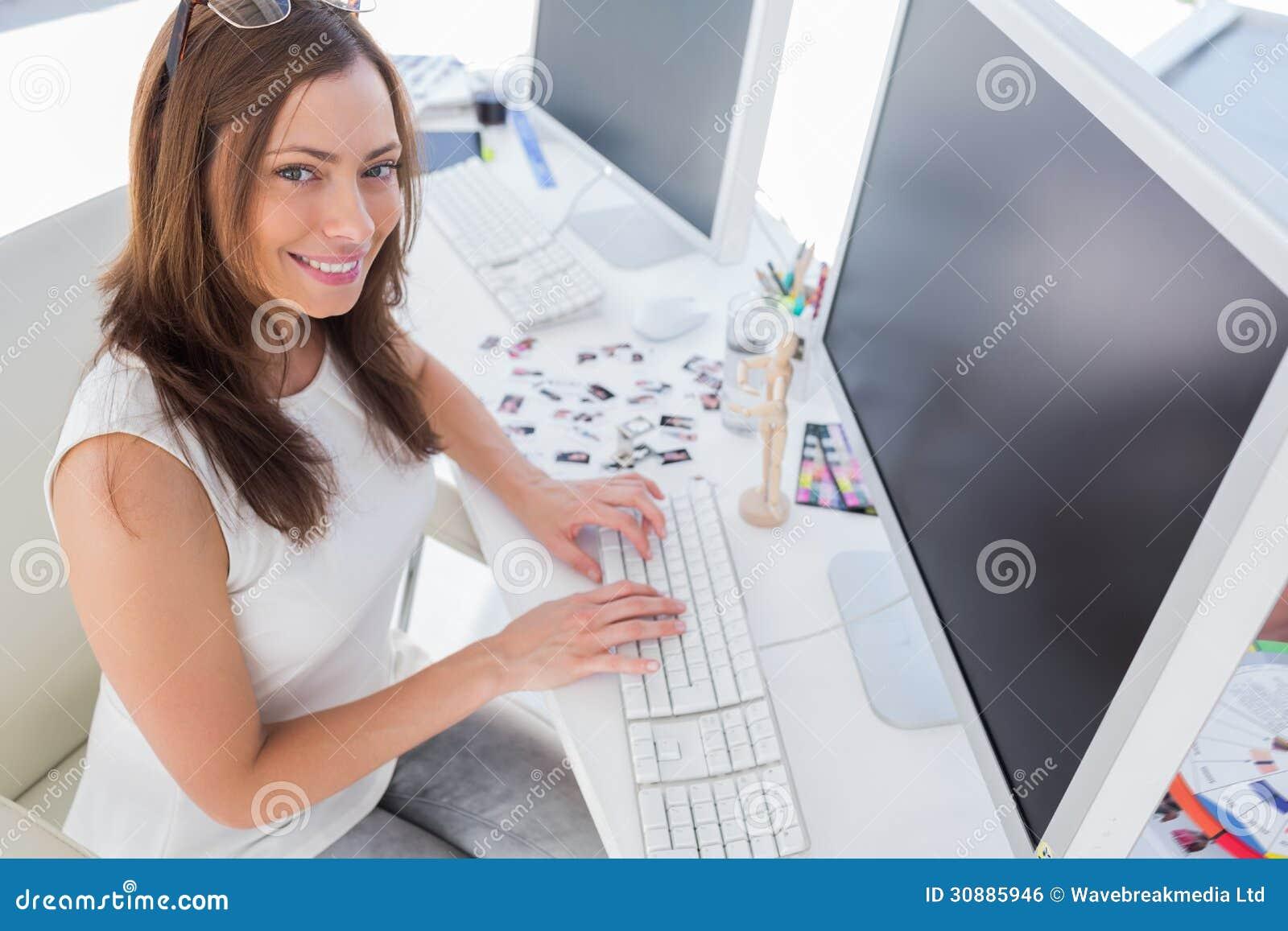 Smiling photo editor at work