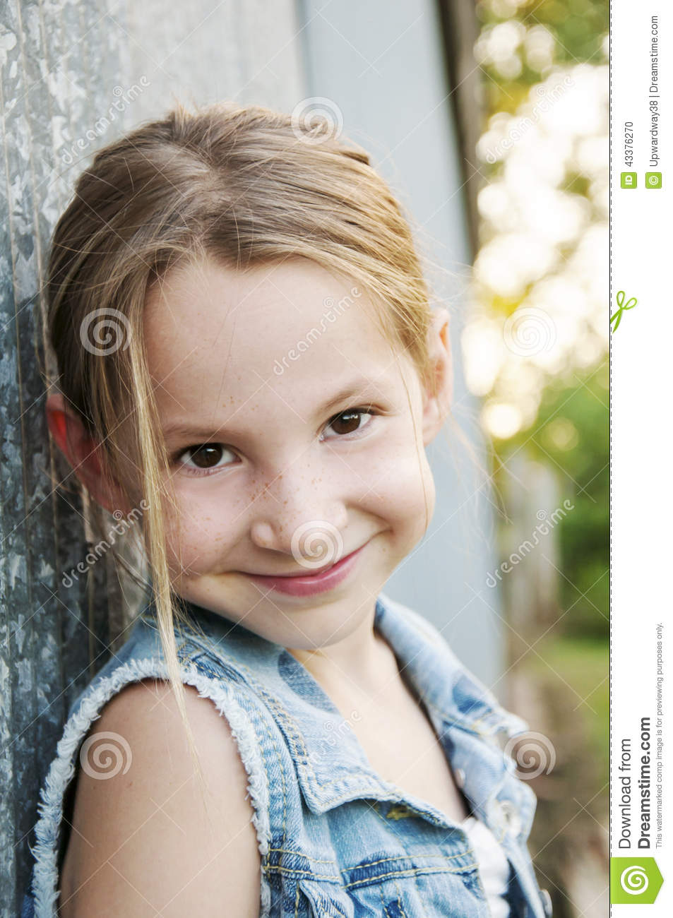 Smiling Pre Teen In Denim Jacket Stock Photo Image 43376270