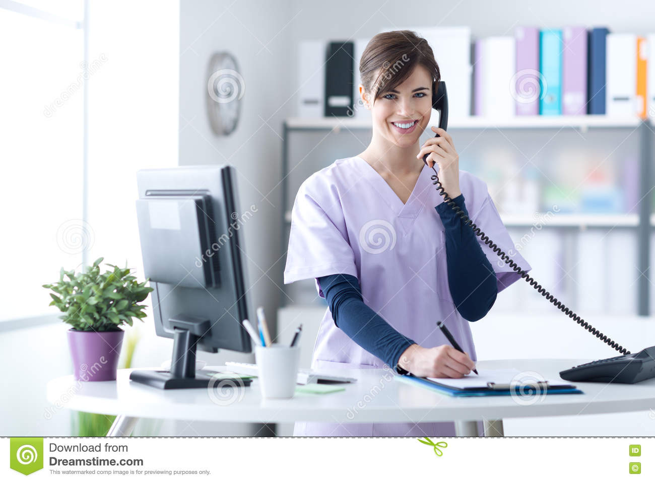 Smiling Receptionist At The Clinic Stock Photo Image