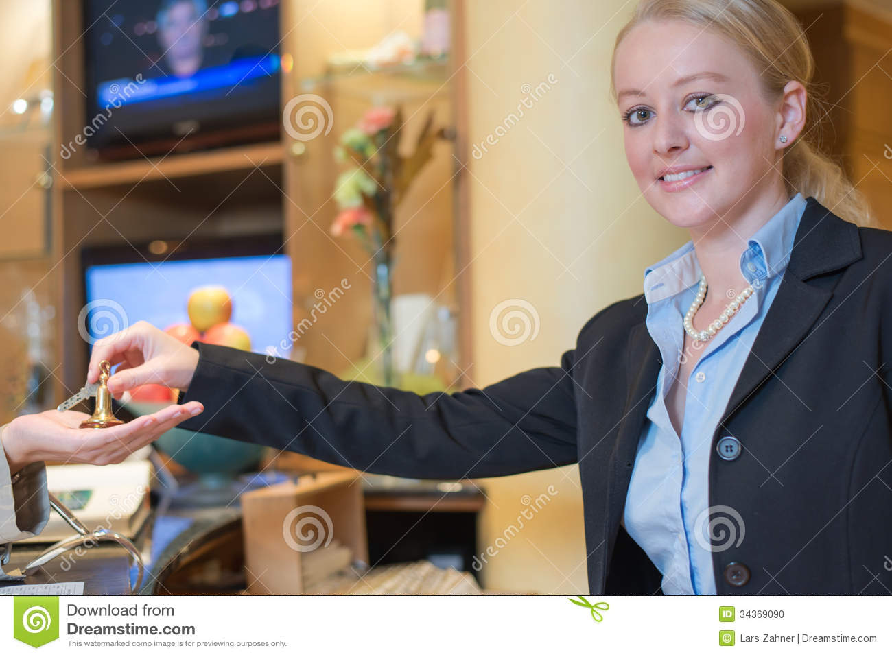 Smiling Receptionist Handing Over Room Keys Stock Photo ...