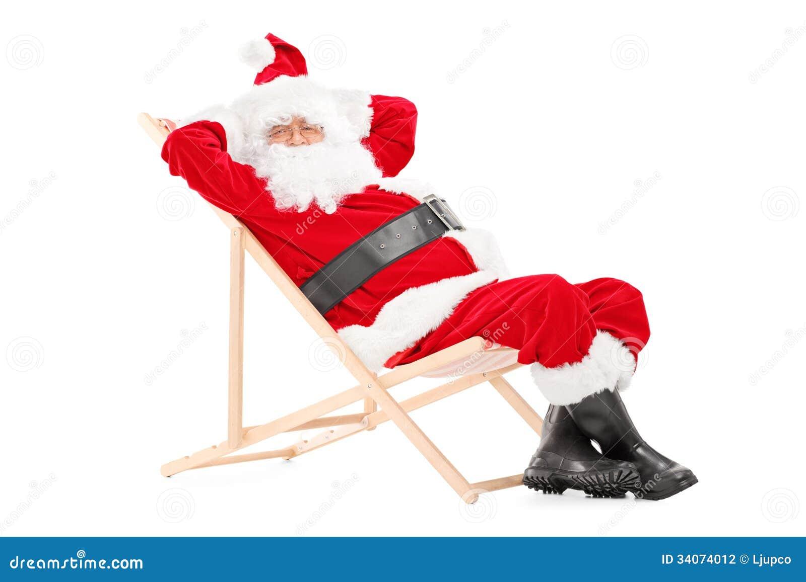 Smiling Santa Claus on a beach chair looking at camera