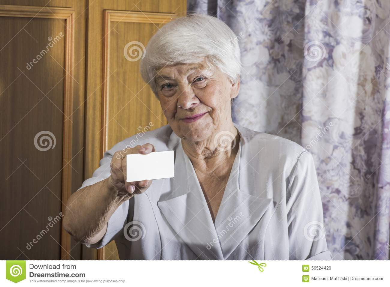 Smiling senior businesswoman holding blank empty business card o download smiling senior businesswoman holding blank empty business card o stock image image of concept reheart Image collections