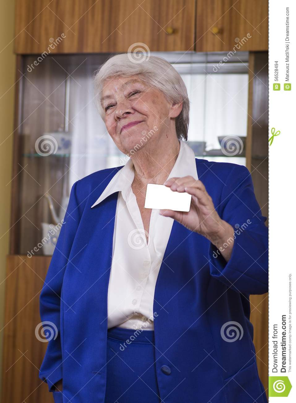 Smiling senior businesswoman holding blank empty business card o download smiling senior businesswoman holding blank empty business card o stock photo image of hand reheart Image collections