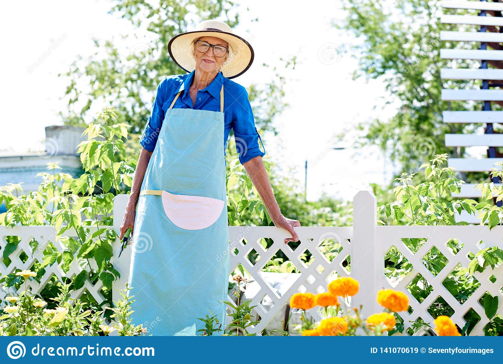 Smiling Senior Gardener Posing