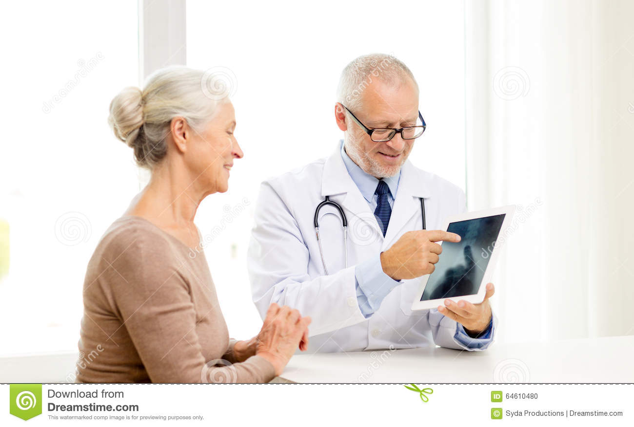 Smiling Senior Woman And Doctor With Tablet Pc Stock Photo ...
