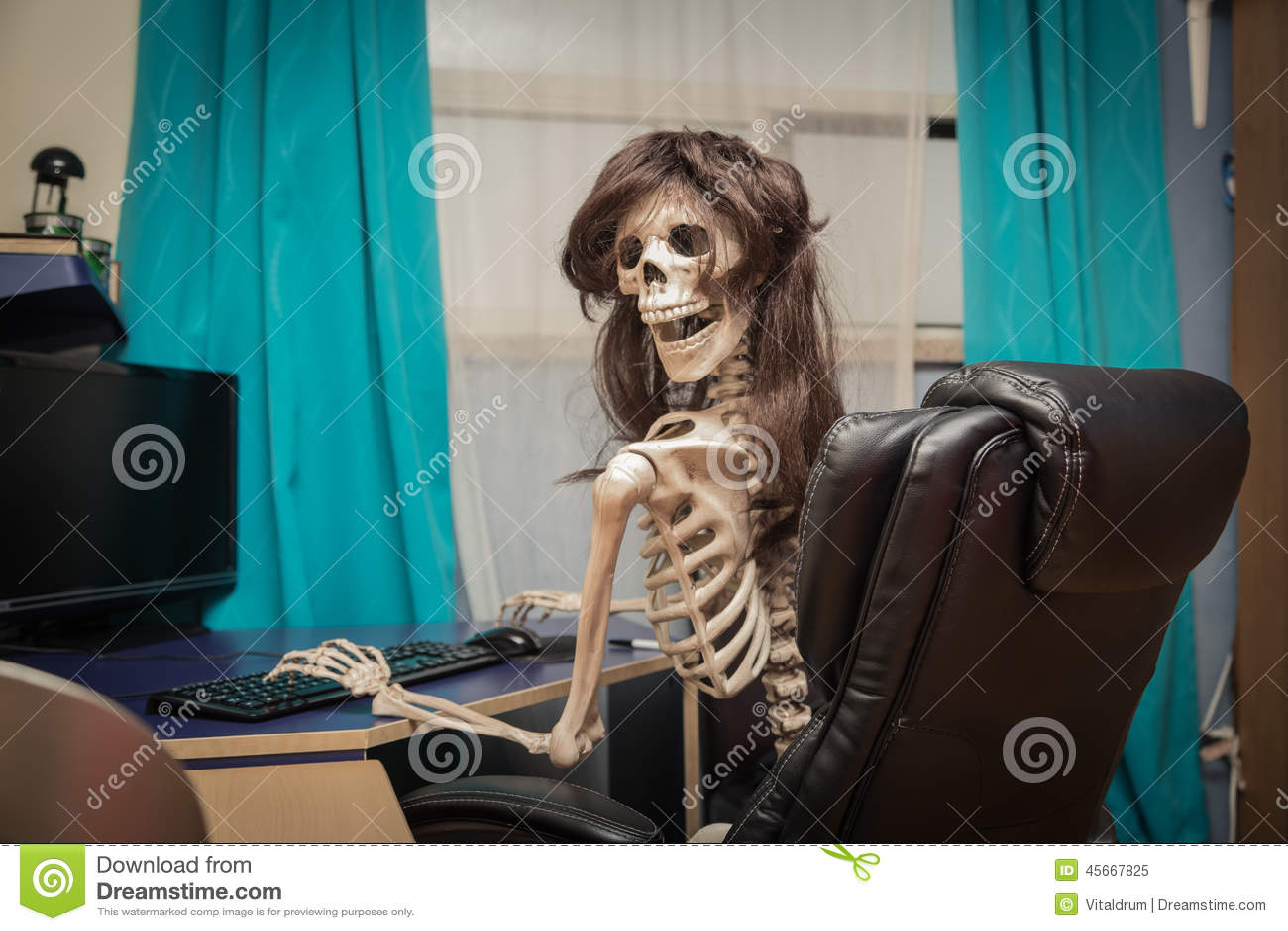 Skeleton In Office Chair Smiling skeleton in a wig sitting in room on