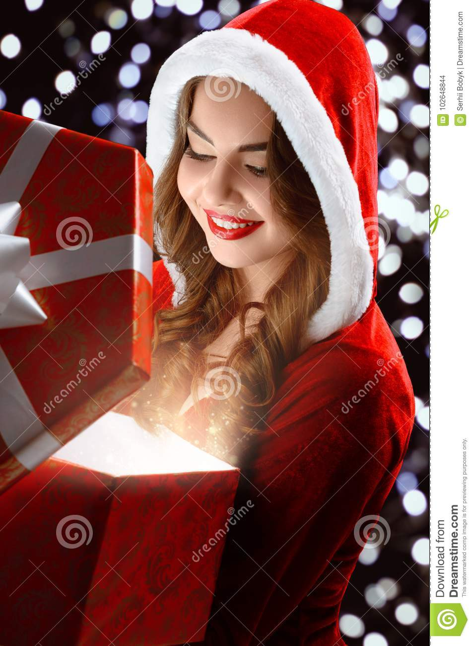 Smiling Snow Maiden In Red Suit Opens A Gift For New Year 2018,2019 ...