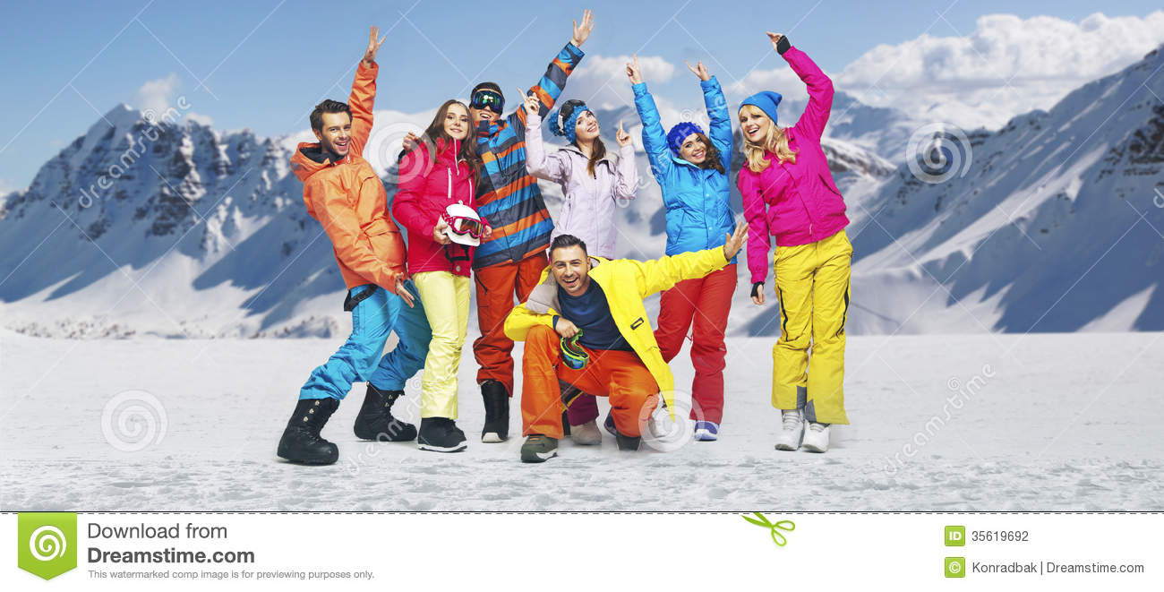 Download Smiling Snowboarders In Funny Poses Stock Photo