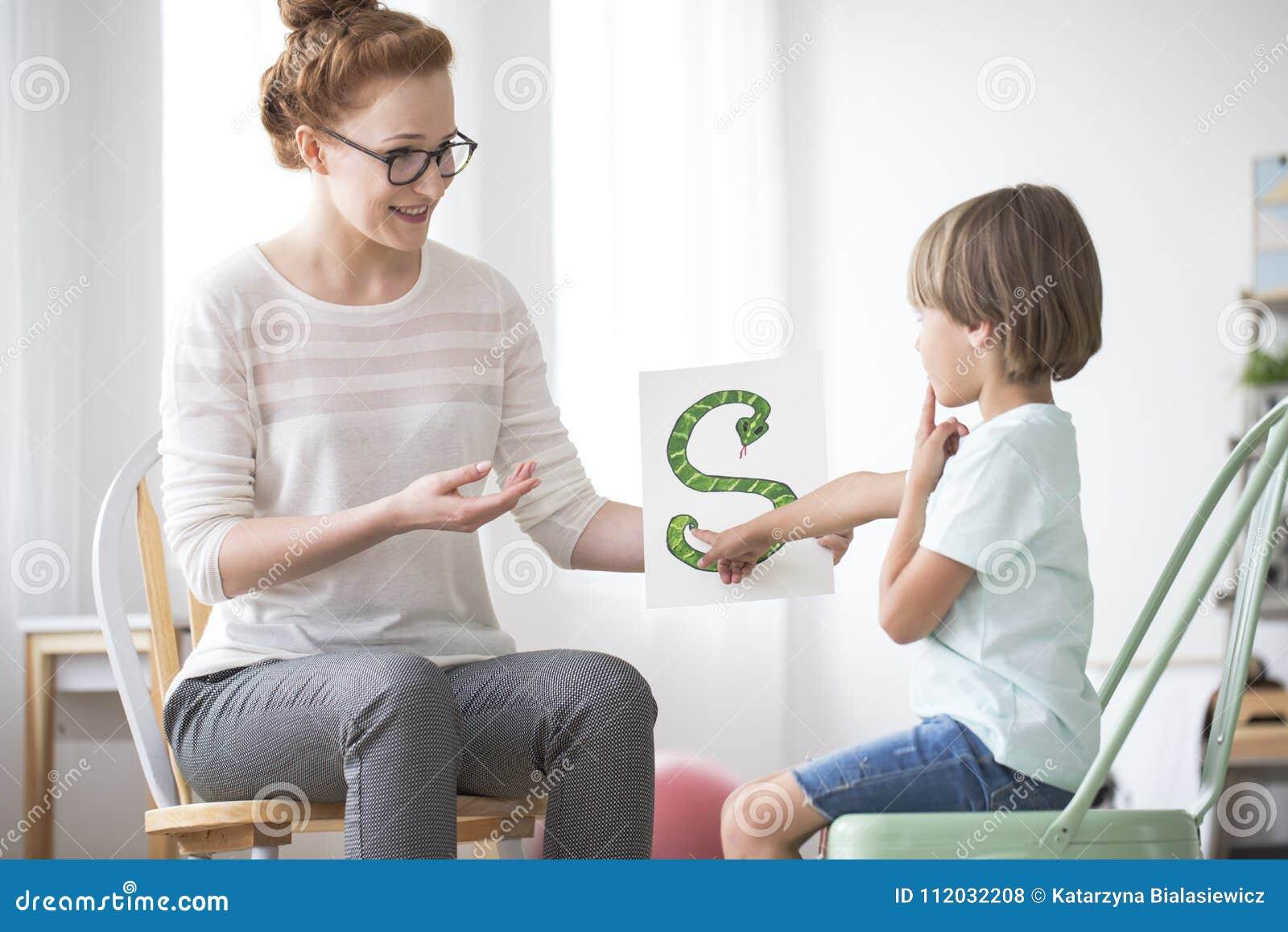Smiling Speech Teacher And Boy Stock Photo - Image of