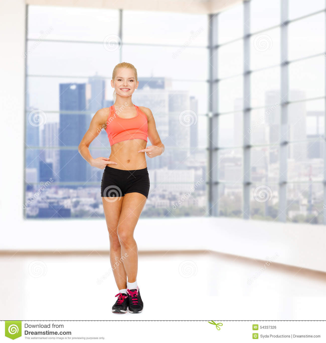 Smiling Sporty Woman Pointing At Her Six Pack Stock Photo ...