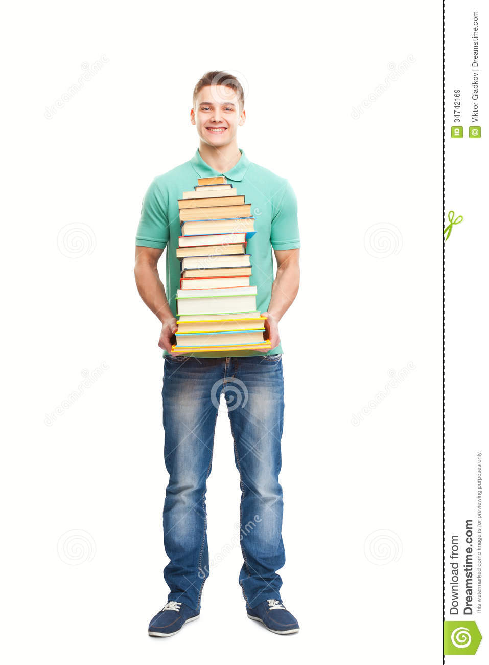 Smiling student holding big stack of books