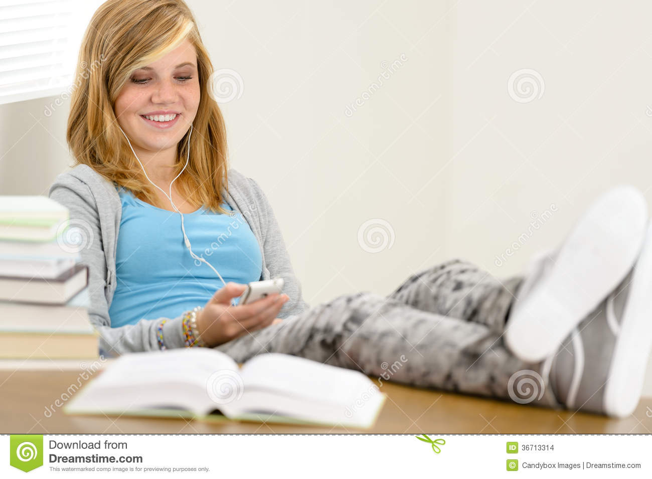 Smiling Student Teenager Relaxing Legs On Table Stock
