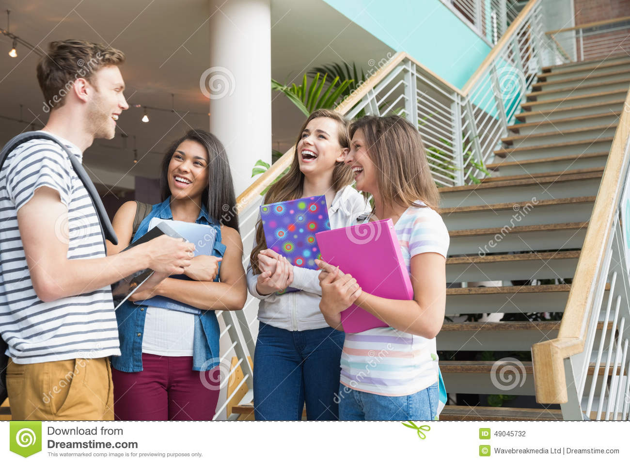 Convenient Products For pensters - Insights smiling students chatting together outside university 49045732