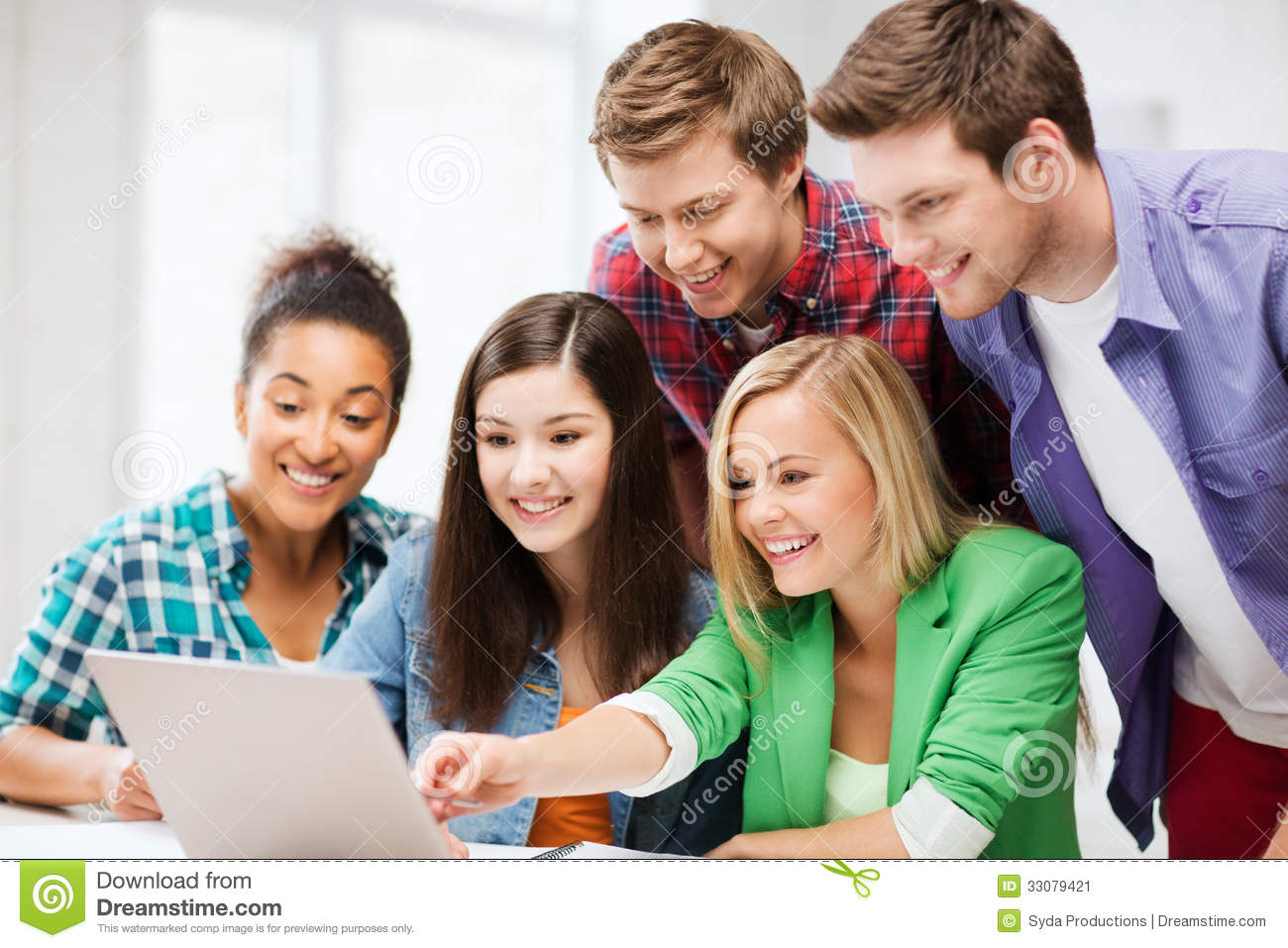 smiling students looking at laptop at school stock image students working together clipart two students working together clipart
