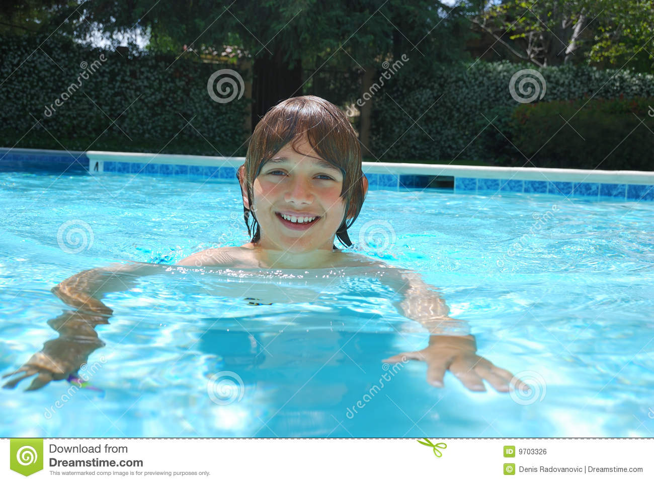 Smiling Teen Boy Swimming In Pool Royalty Free Stock Image -6381