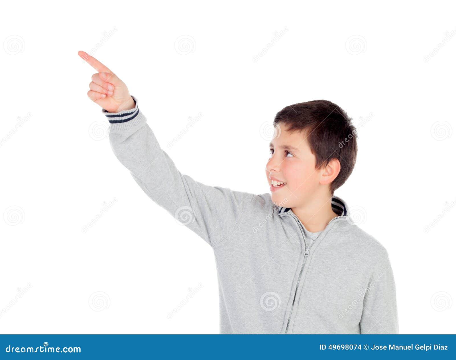 Smiling teenage boy of thirteen indicating something