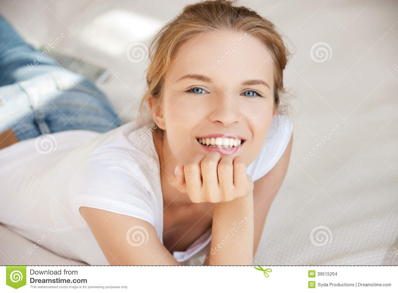 Smiling teenage girl on a bed