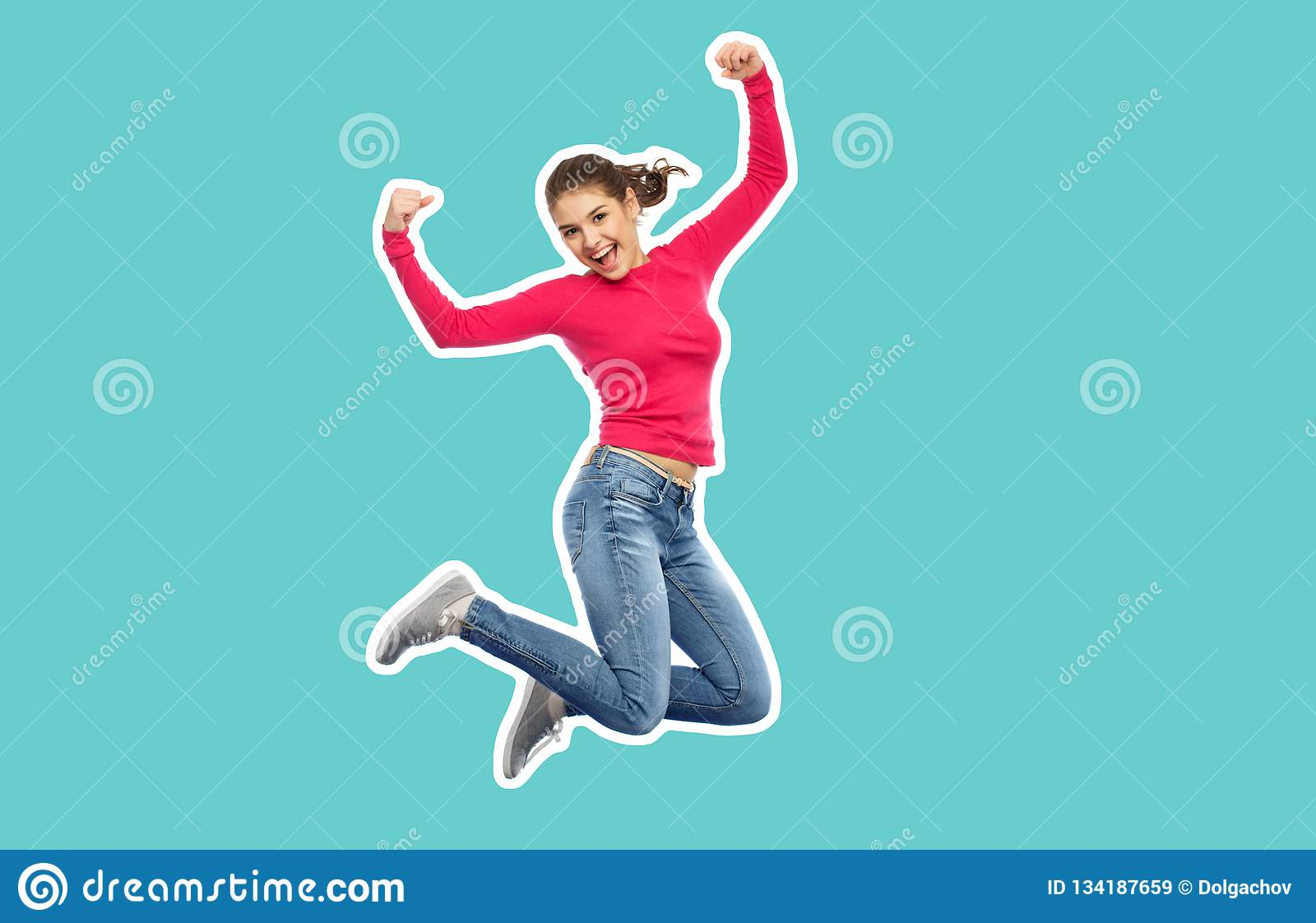 Smiling teenage girl jumping in air