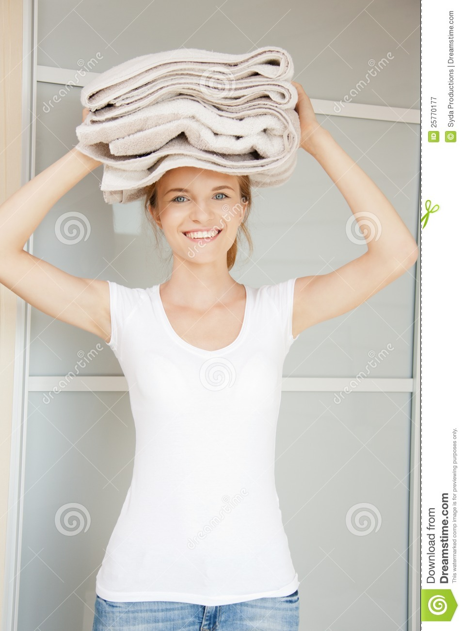 Picture of smiling teenage girl with towels.