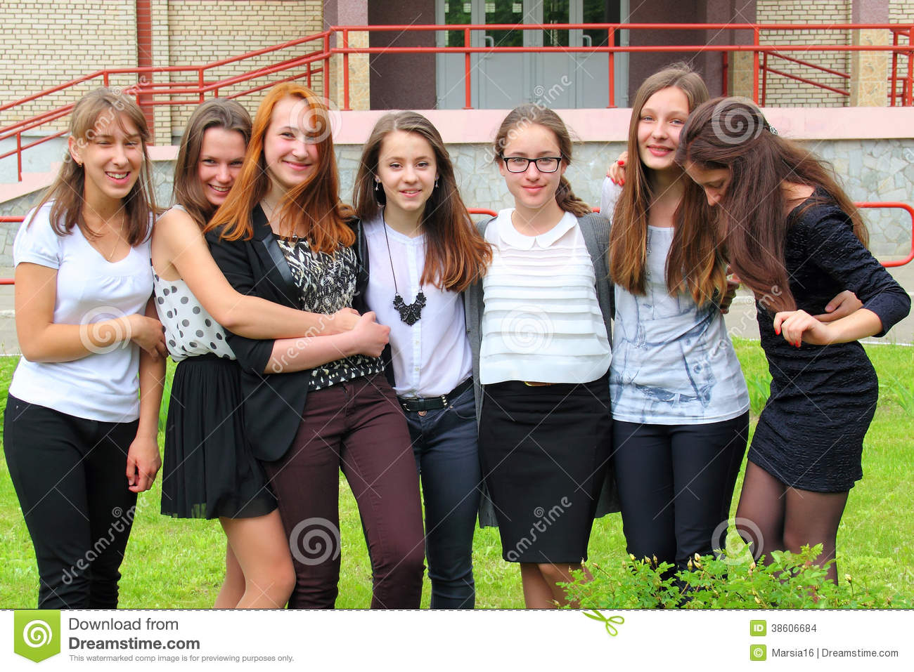 Group Of Seven Teenage Girls Outside School Standing Still and Smiling ...