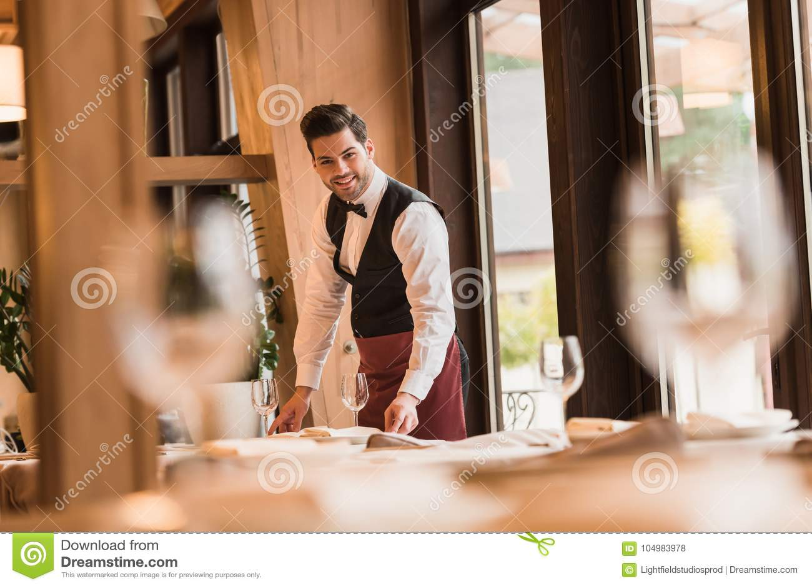 Waiter serving tables