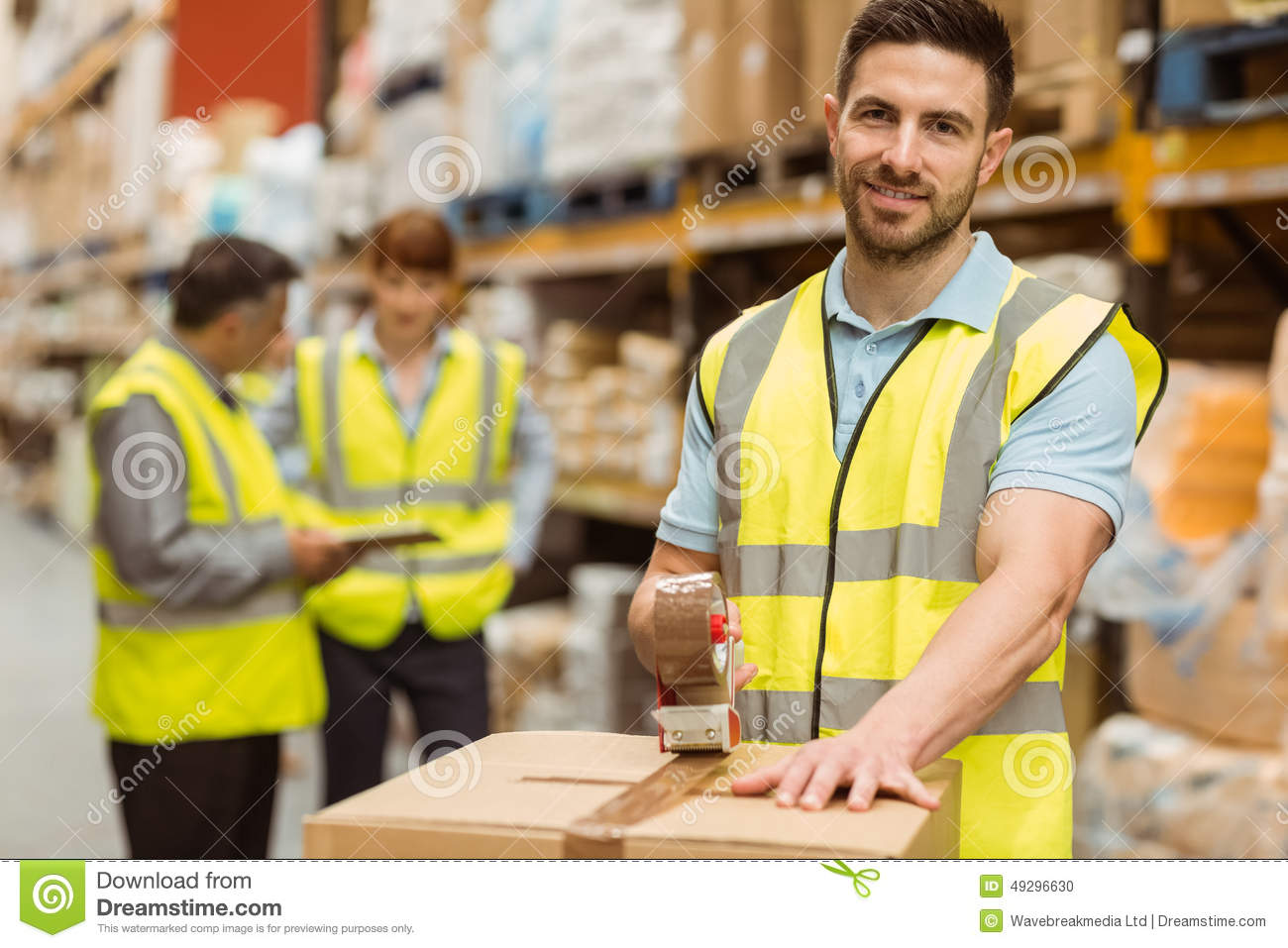 Smiling warehouse workers preparing a shipment