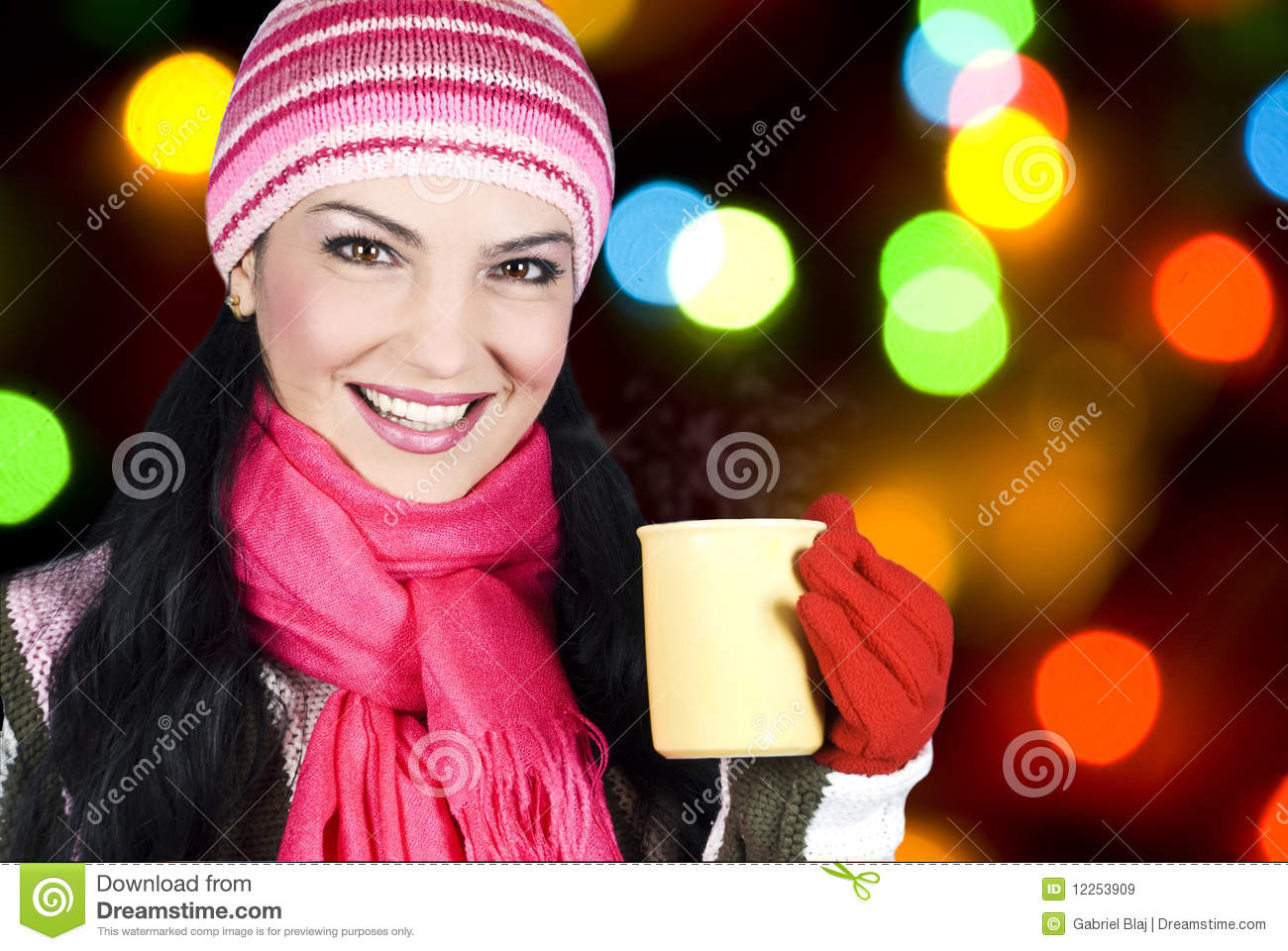 Smiling winter woman holding hot tea