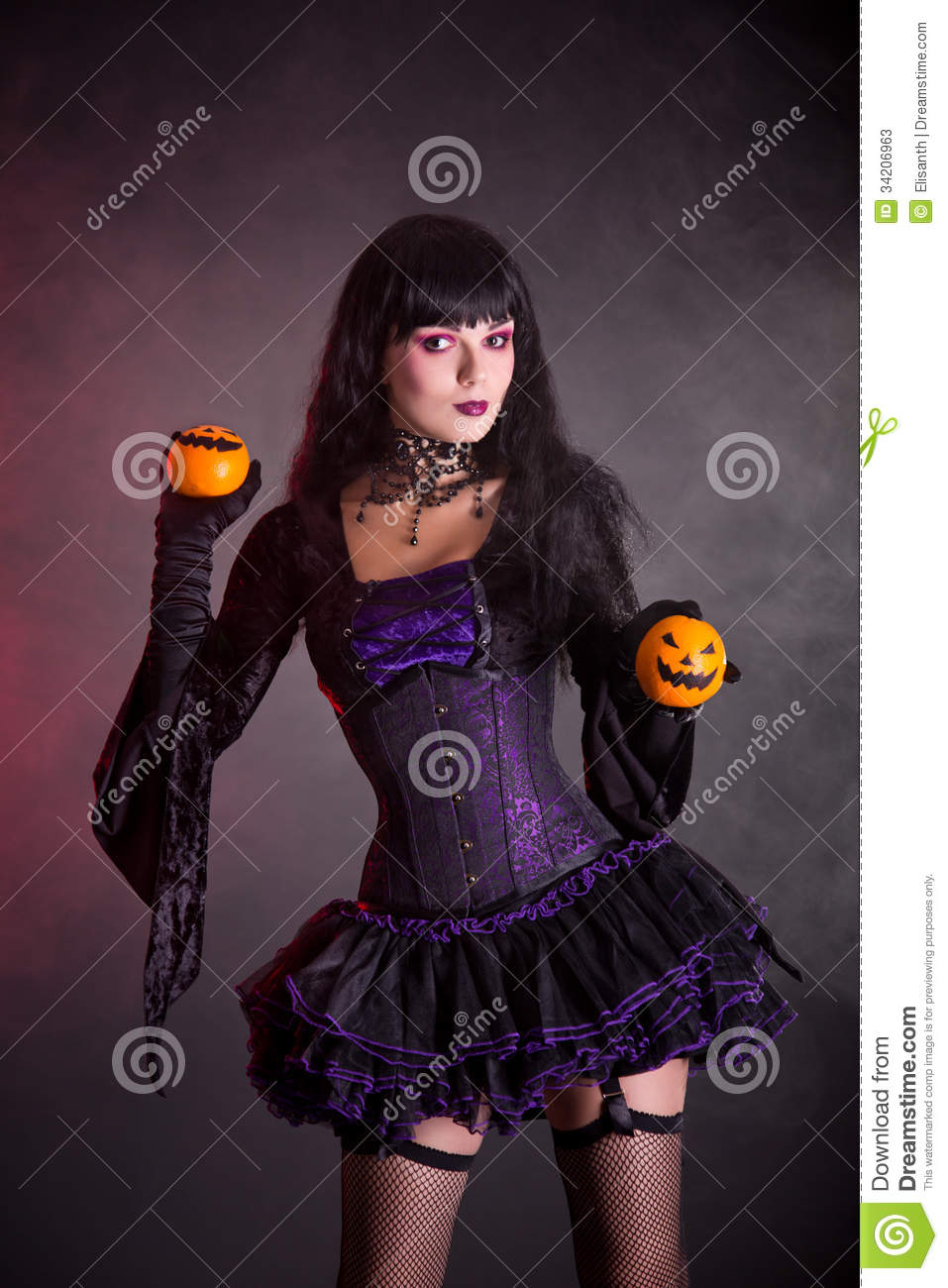 Black dress up gloves - Smiling Witch In Purple Gothic Halloween Costume Stock