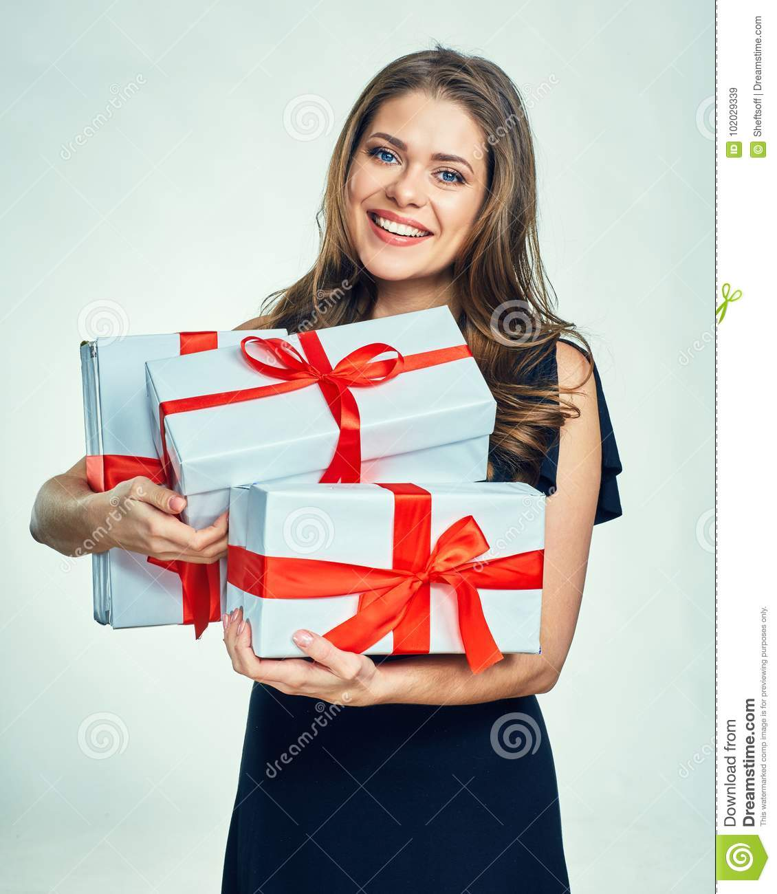 Smiling Woman In Black Evening Dress Holding Gift Box ...