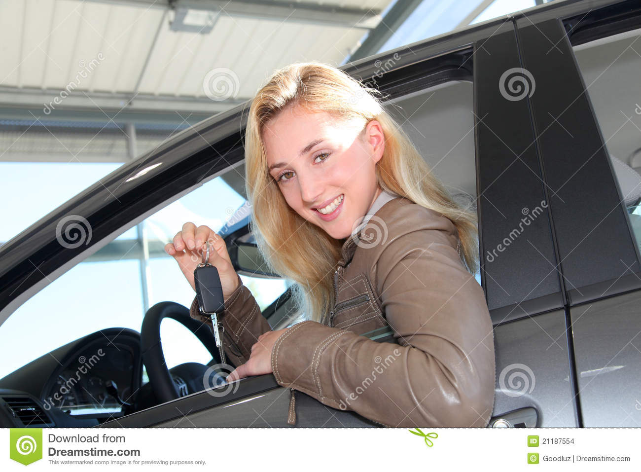 Smiling woman buying new car