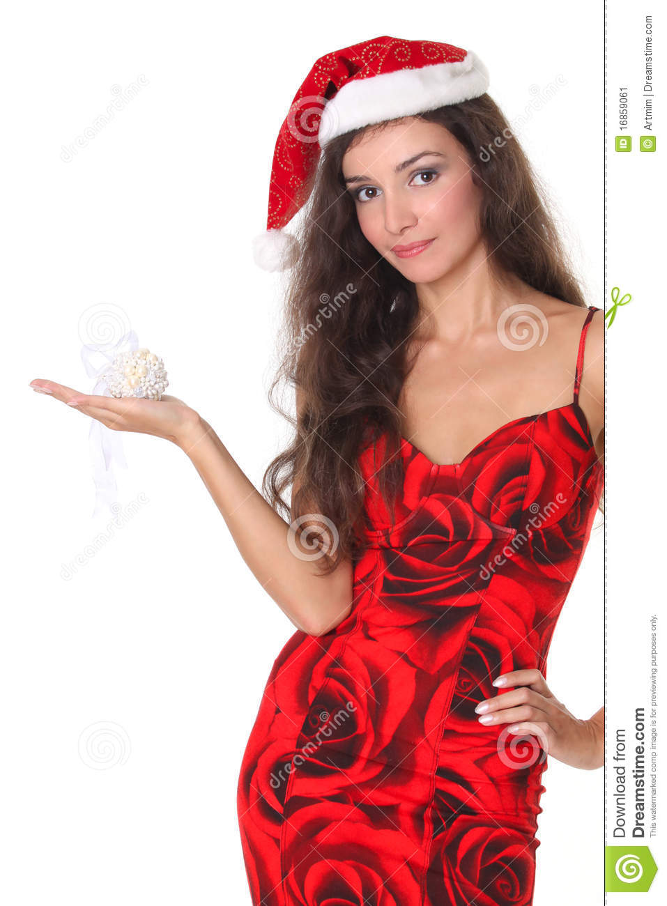 Smiling woman in red dress with christmas ball
