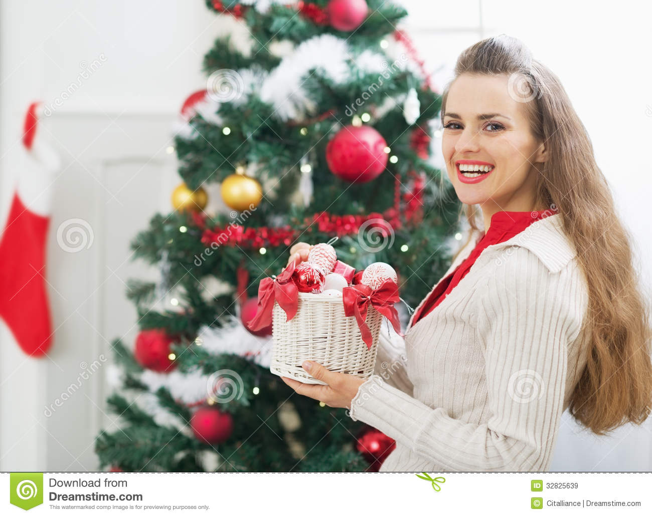 Smiling woman with christmas decorations near christmas for Christmas decorations near me