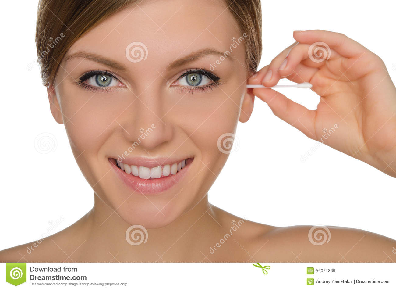 Smiling woman cleans ears with cotton sticks