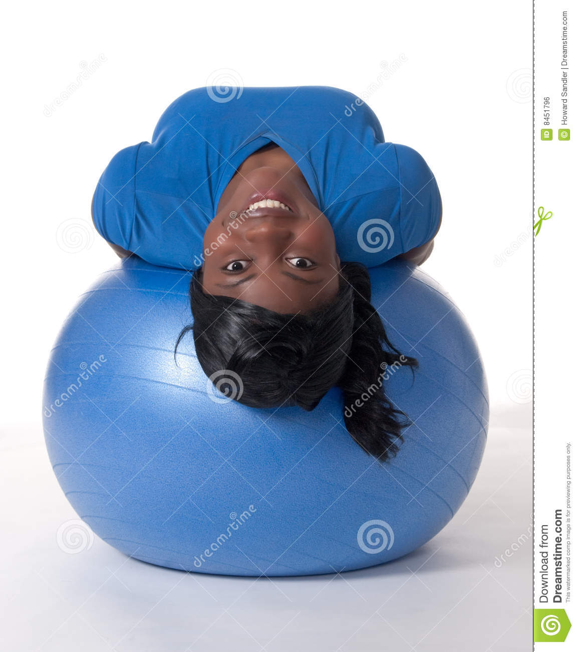 Smiling woman on exercise ball