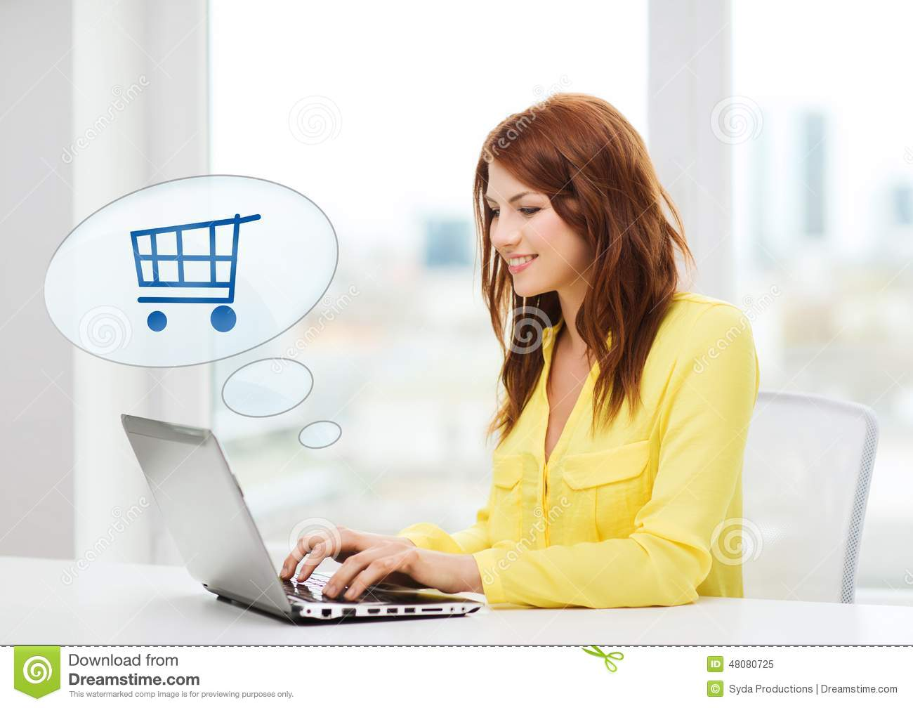 Smiling woman with laptop computer shopping online stock for Online shopping for the home