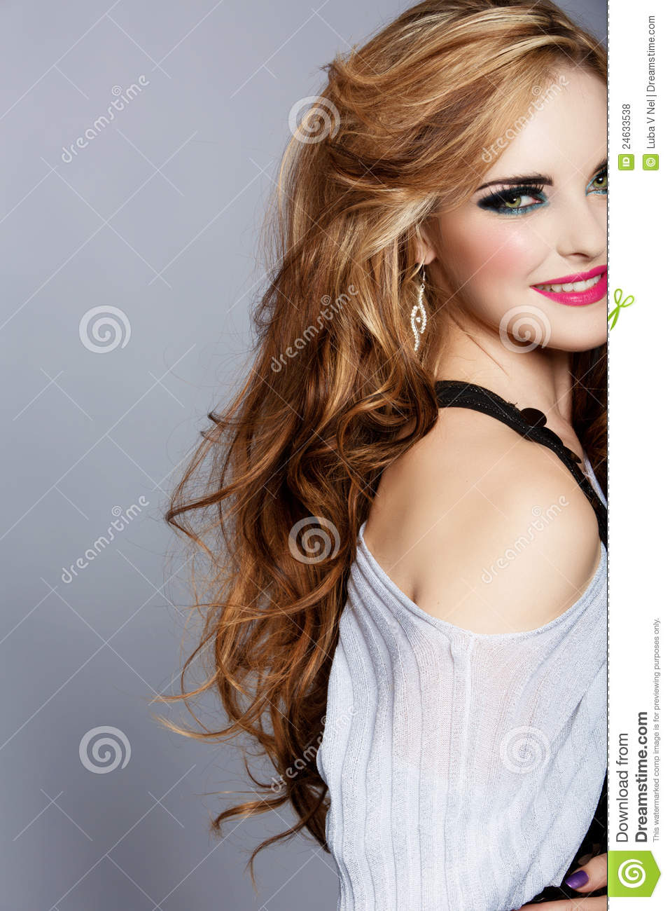Smiling woman with long curly hair and pink lipstick