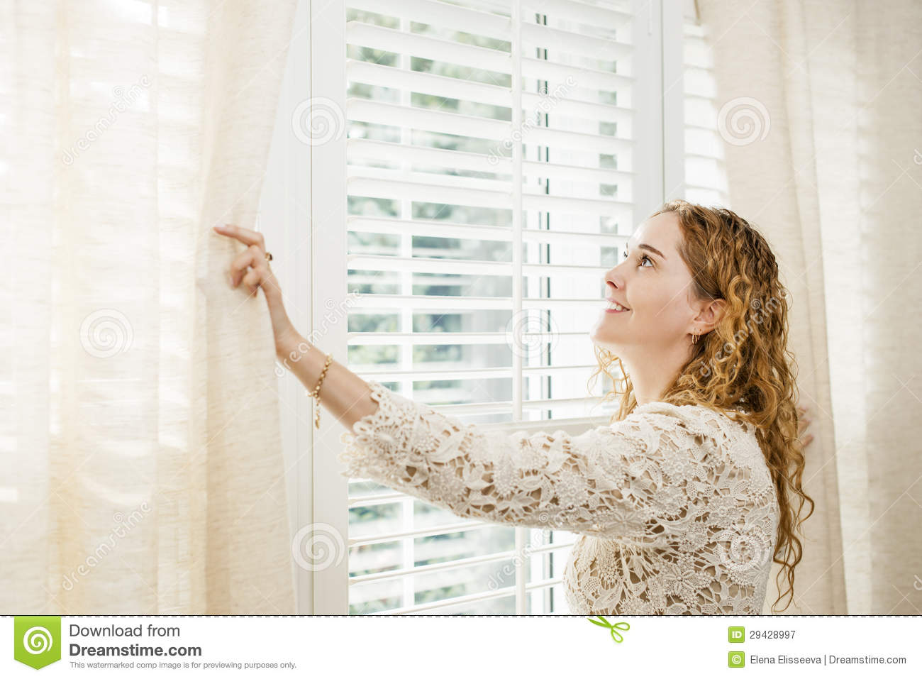 Download Smiling Woman Looking Out Window Stock Image - Image of curtain, california: 29428997