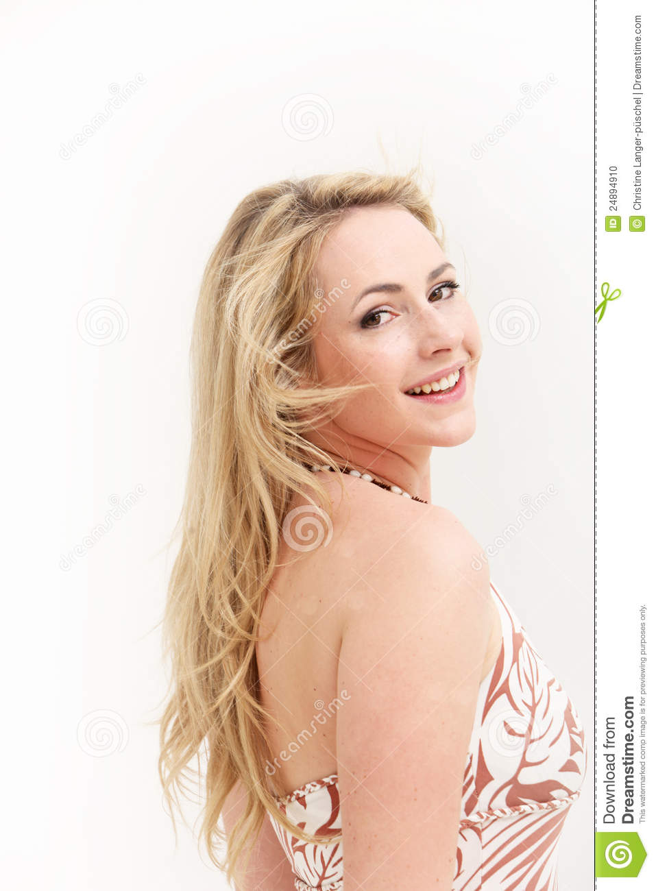 Smiling woman looking over her shoulder