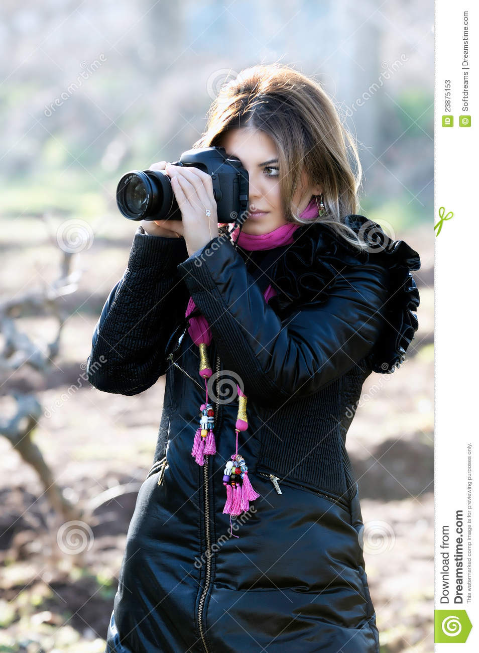 Smiling woman and photo camera