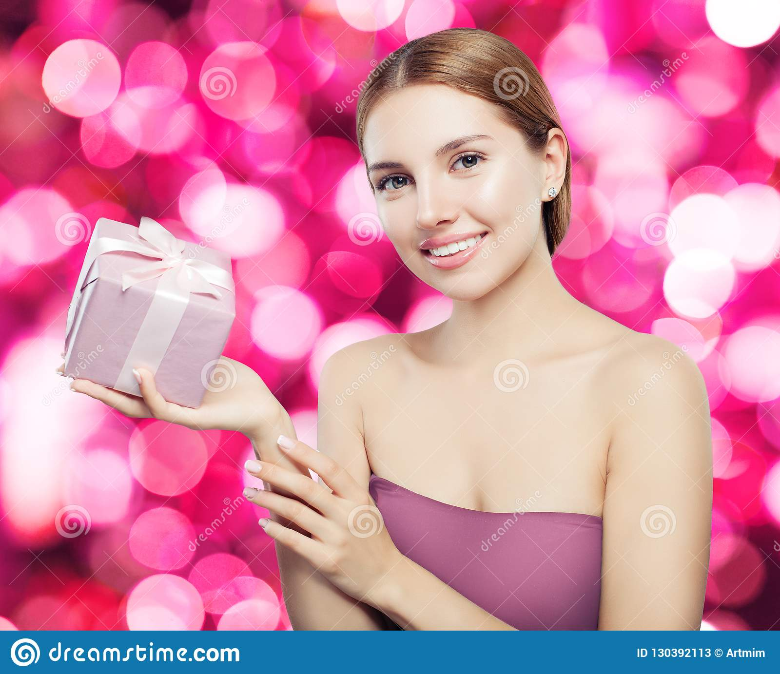Smiling Woman With Pink Gift On Celebration Bokeh ...