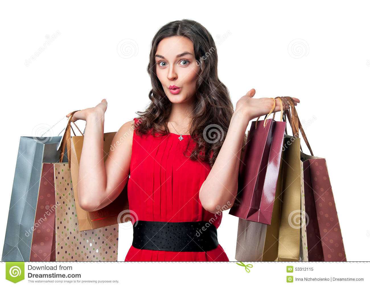 Gifts christmas smiling woman in red dress with shopping bags