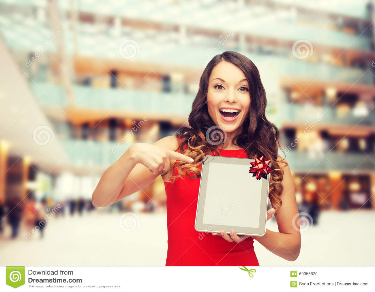Technology present and people concept smiling woman in red dress