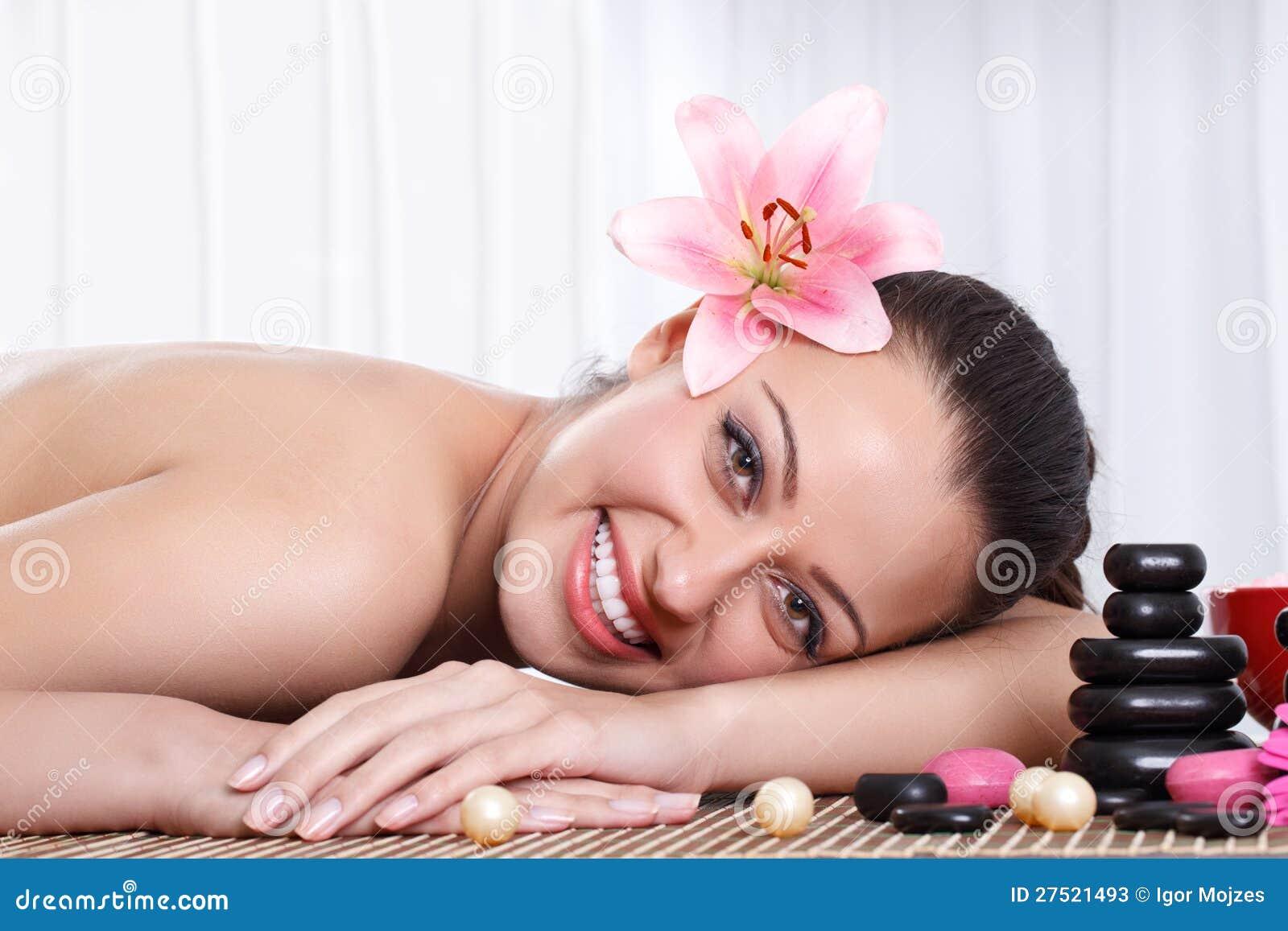 Smiling Woman In Spa Salon Stone Massage Stock s
