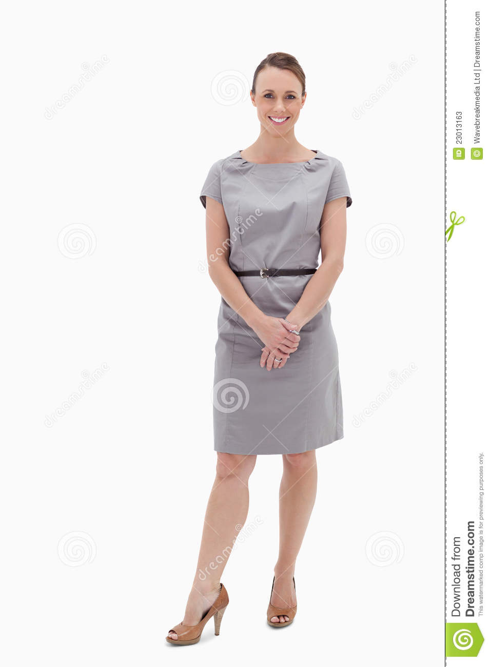 Smiling Woman Standing Up And Holding Her Hands Stock ...