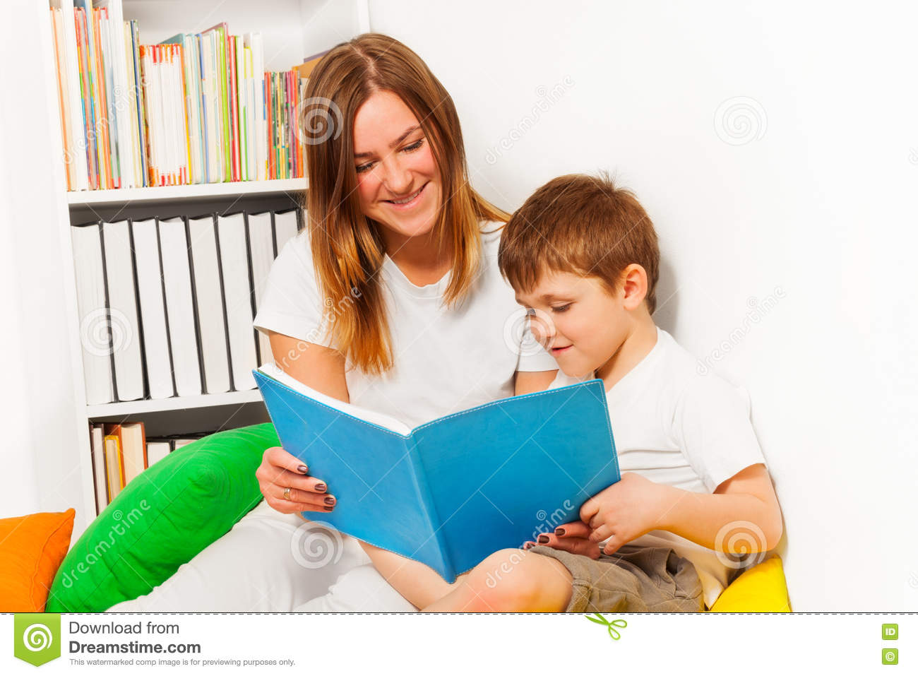 Smiling Woman Teaching Her Kid Boy To Read Stock Photo - Image ...